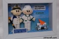 boneka pasangan pelaut dan bidan